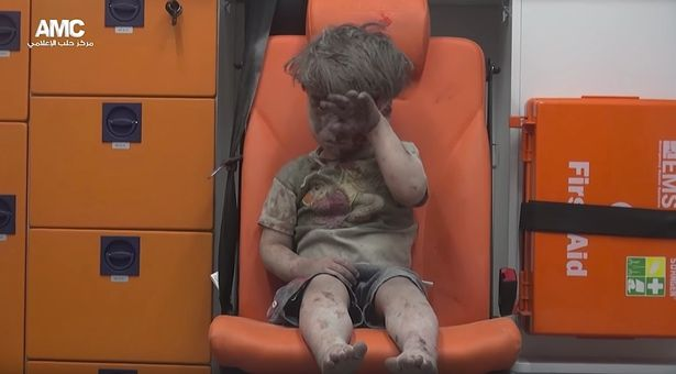 Syrian-child-pulled-from-Aleppo-rubblen