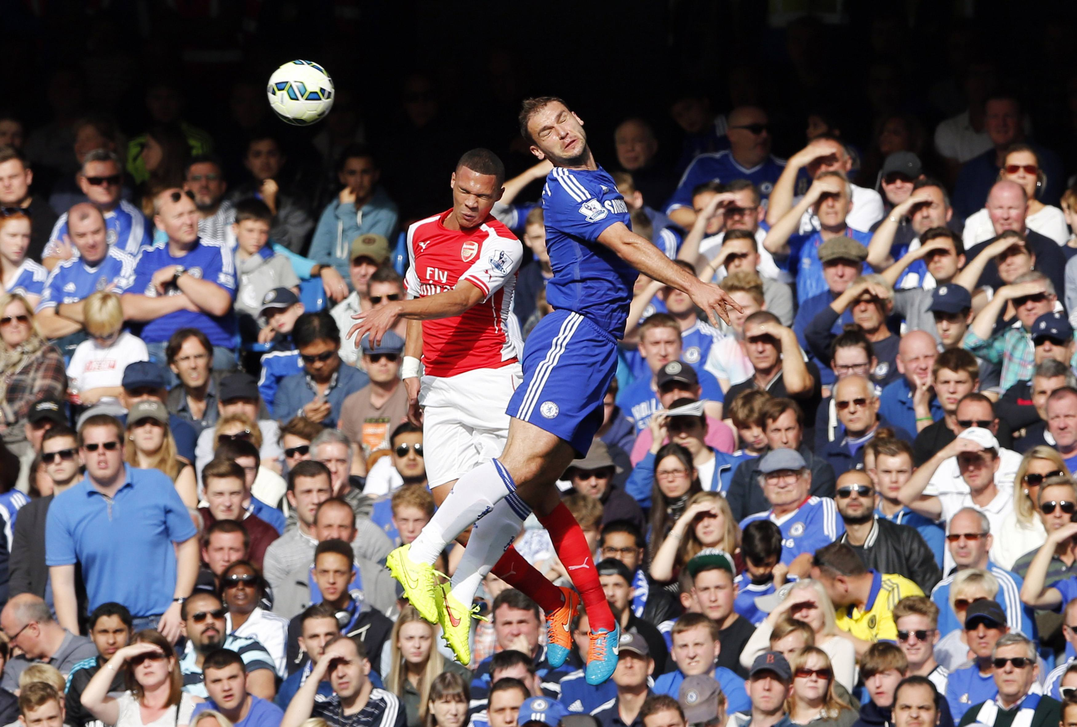 "REFILE - CORRECTING BYLINE Chelsea's Branislav Ivanovic (R) challenges Arsenal's Kieran Gibbs during their English Premier League soccer match at Stamford Bridge in London October 5, 2014. REUTERS/Stefan Wermuth (BRITAIN - Tags: SPORT SOCCER TPX IMAGES OF THE DAY) NO USE WITH UNAUTHORIZED AUDIO, VIDEO, DATA, FIXTURE LISTS, CLUB/LEAGUE LOGOS OR ""LIVE"" SERVICES. ONLINE IN-MATCH USE LIMITED TO 45 IMAGES, NO VIDEO EMULATION. NO USE IN BETTING, GAMES OR SINGLE CLUB/LEAGUE/PLAYER PUBLICATIONS. FOR EDITORIAL USE ONLY. NOT FOR SALE FOR MARKETING OR ADVERTISING CAMPAIGNS"