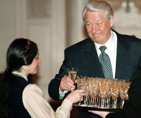 Russian President Boris Yeltsin (R) and an unidentified teacher take glasses of champagne during an awards ceremony in the Kremlin January 26, 1998. Yeltsin, who buried the Soviet Union then led Russia through its chaotic first years of independence, died on April 23, 2007 aged 76, the Kremlin said. REUTERS/Yuri Kadobnov/Pool/Files (RUSSIA)