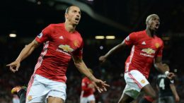 Manchester United's Swedish striker Zlatan Ibrahimovic (L) celebrates with Manchester United's French midfielder Paul Pogba after scoring their second goal from the penalty spot during the English Premier League football match between Manchester United and Southampton at Old Trafford in Manchester, north west England, on August 19, 2016. / AFP / Oli SCARFF / RESTRICTED TO EDITORIAL USE. No use with unauthorized audio, video, data, fixture lists, club/league logos or 'live' services. Online in-match use limited to 75 images, no video emulation. No use in betting, games or single club/league/player publications.  /         (Photo credit should read OLI SCARFF/AFP/Getty Images)